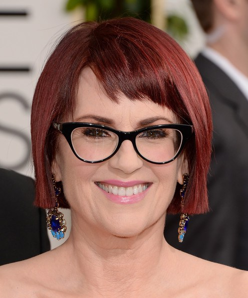 classy short bob hairstyle for older women with glasses
