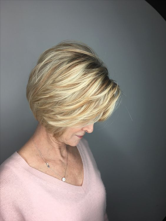 pretty side parted balayage bob hairstyle for women over 50