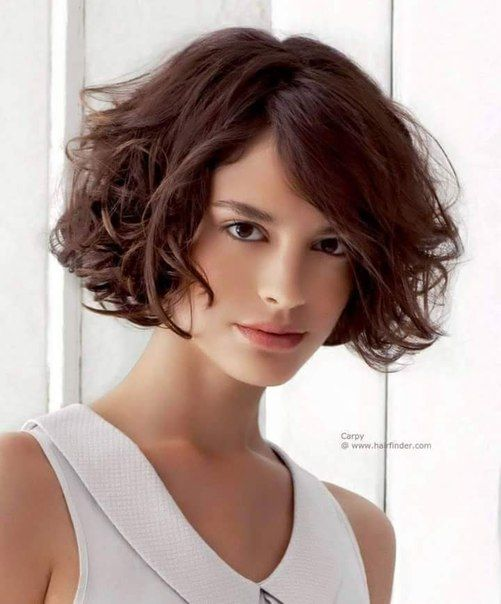 a curly short bob hairstyle that looks awesome for round face woman volume_layer_packed_lob_hairstyle_8