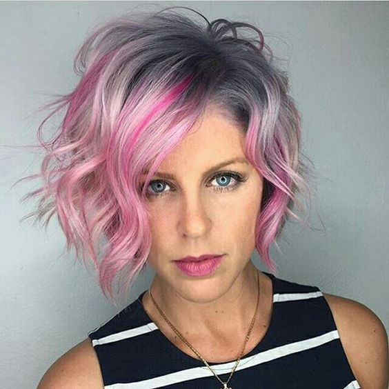 awesome pink color on curly bob hairstyle