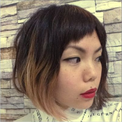 razored bob with uneven bangs