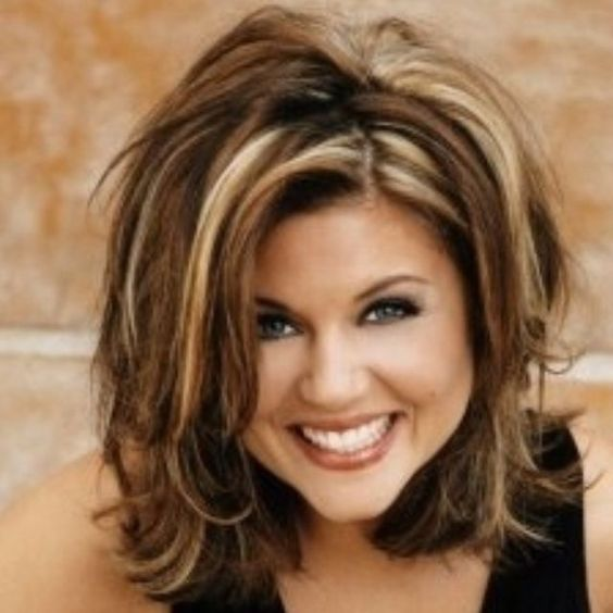 beautiful layered shag hairstyle for women over 50 with thick hair