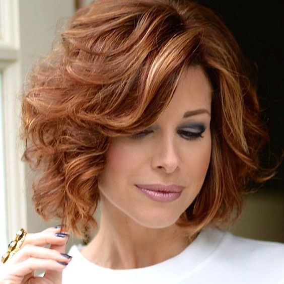 beautiful wavy short shag haircut style for women over 50 with thick hair
