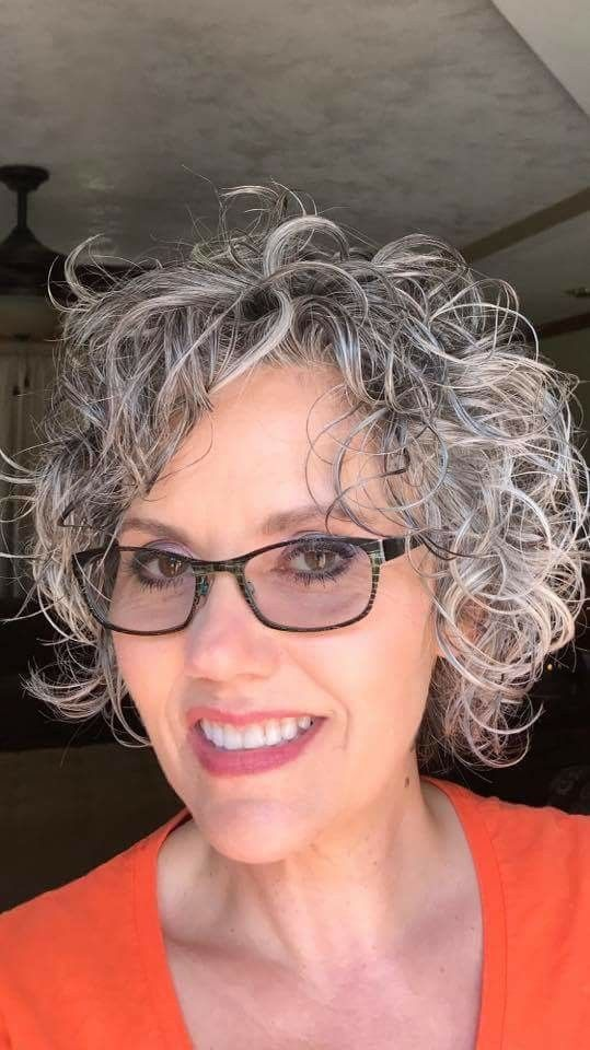 cute-curly-hairstyle-for-over-60-women-with-glasses-and-grey-hair ...