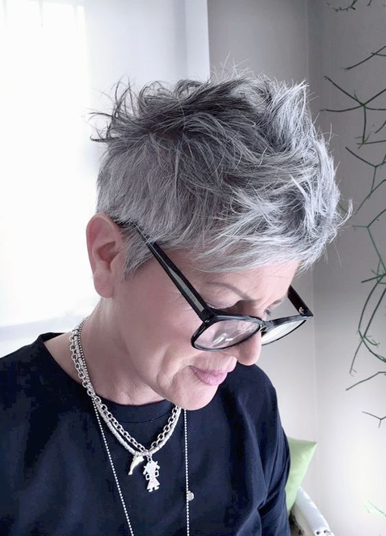 messy short pixie haircut for over 60 women with glasses