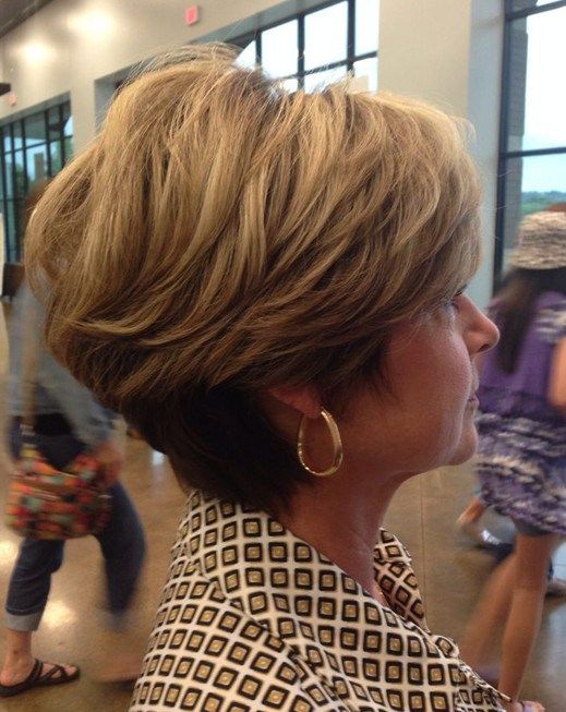 pretty layered wedge haircut for women over 60 with thick hair