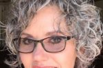 Unique Curly Hairstyle For Over 60 Women With Glasses