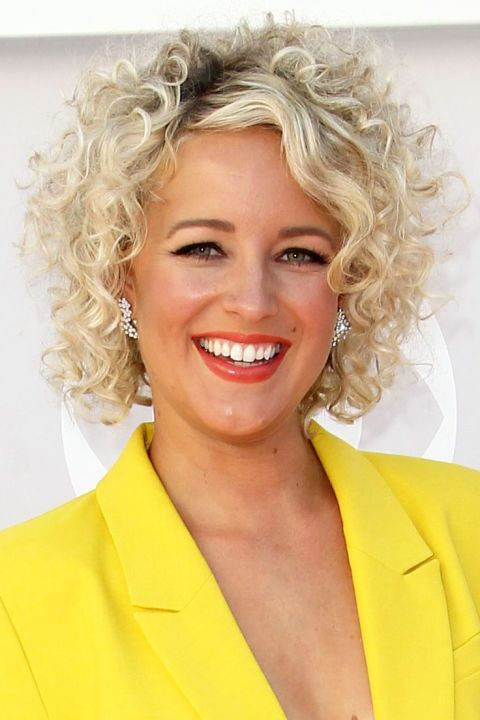 54 Awesome Short Curly Hairstyles for Women over 50 beautiful-curly-hairstyle-with-side-swept-bangs