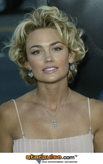 trendy-middle-parted-short-curly-hair-for-older-women trendy-middle-parted-short-curly-hair-for-older-women