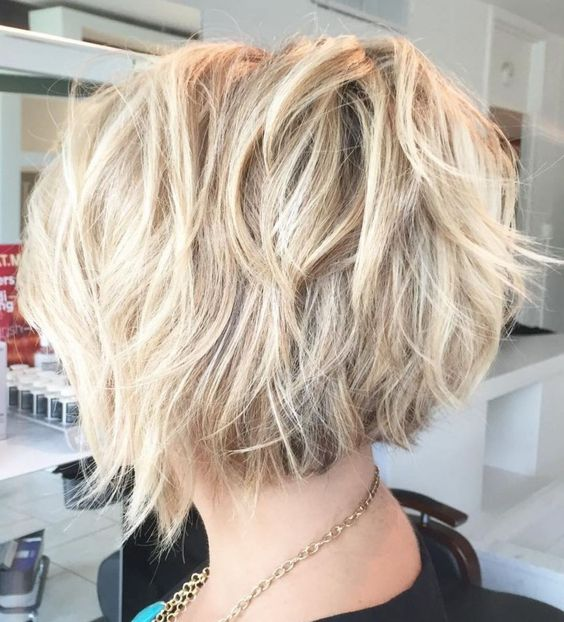 Curly Blonde Crop Stacked Haircut 1