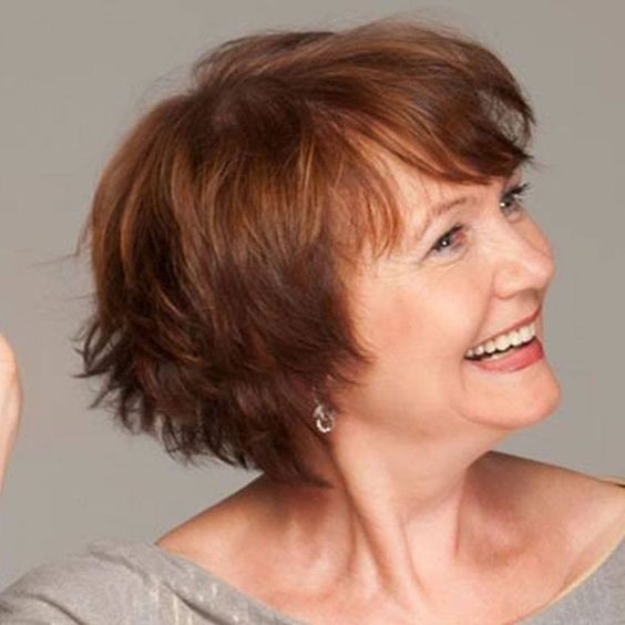 Natural Red Hairstyle for Women Over 50 with Fine Hair 3