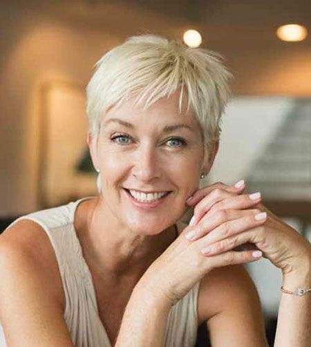 Pretty pixie haircut with bangs for women over 60 5