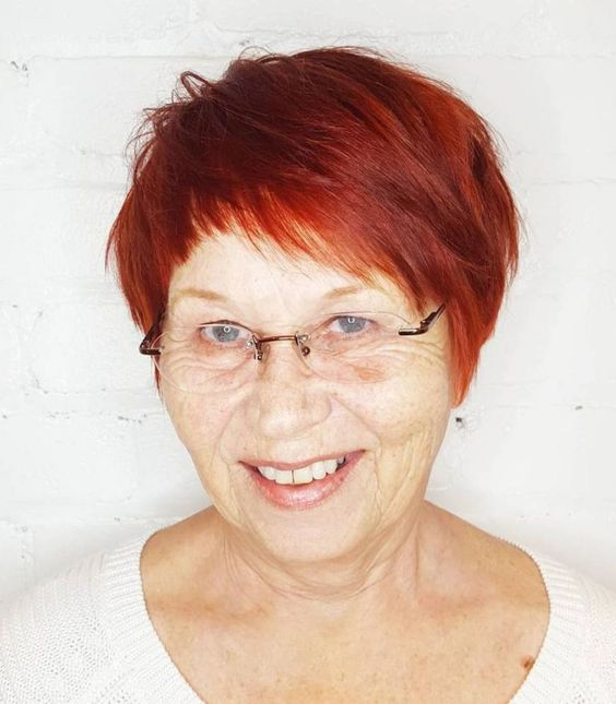 Pretty pixie haircut with bangs for women over 60 7