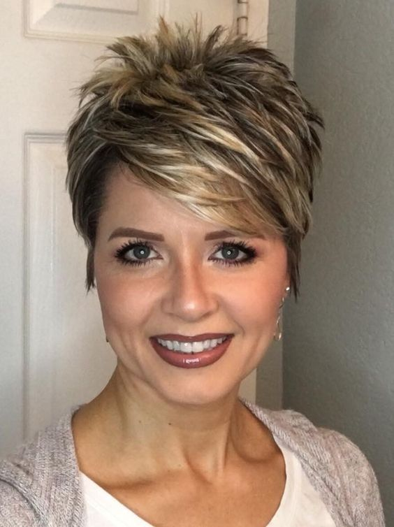 Pretty pixie haircut with bangs for women over 60 9