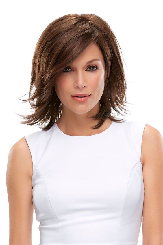 Popular Short Haircuts for Women Over 40 with Thick Hair asymmetric_chic_bob_over_40_hairstyle_7
