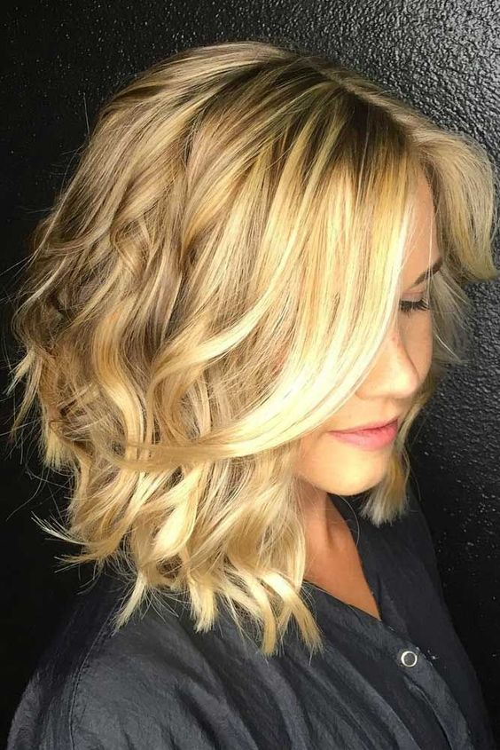 pretty blonde lob hairstyle for women with thick hair