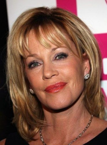 blond cropped hairstyle with long bangs for women over 50