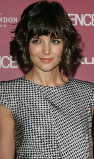 Short curly angled bob with straight bangs