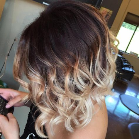 cute short brown bob haircut with curled ends and highlights