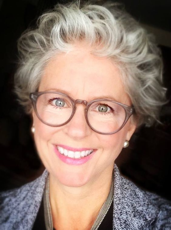 messy curly haircut for older women with grey hair