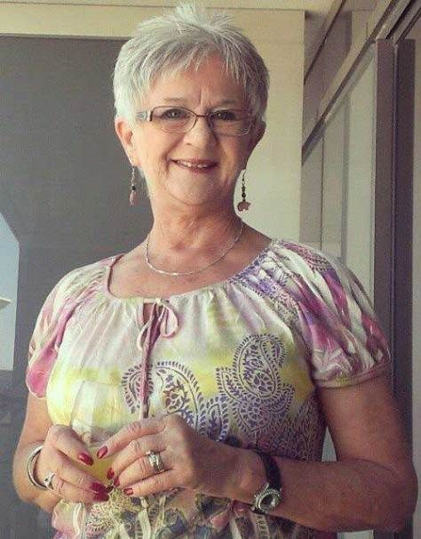 short pixie haircut for older women with gray hair and glasses