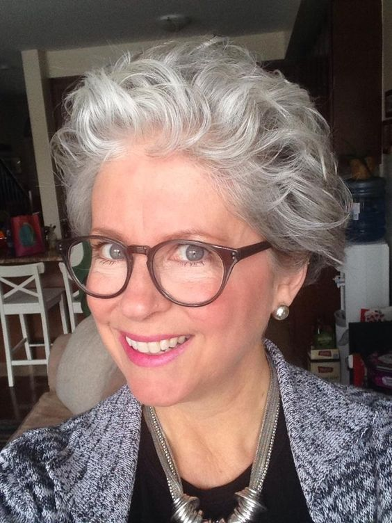 Soft Curly Hairstyle For Older Women With Glasses Short