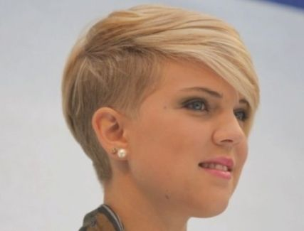 very short and modern side swept haircut for women with thin hair