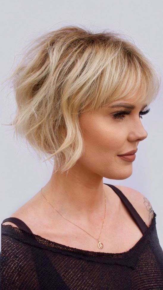 15 Sensual Short Haircut Styles for Older Women that is Awesome in 2021 Wavy-reverse-bob-with-bangs