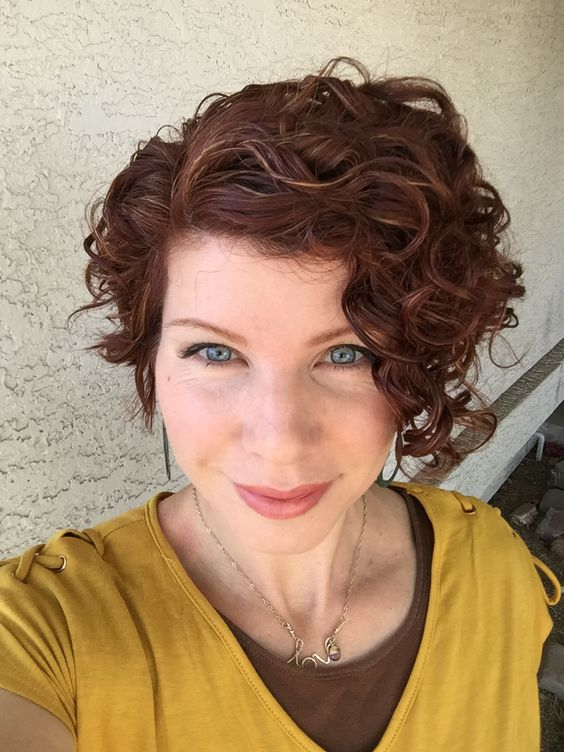 asymmetrical short curly hairstyle for over 50 women