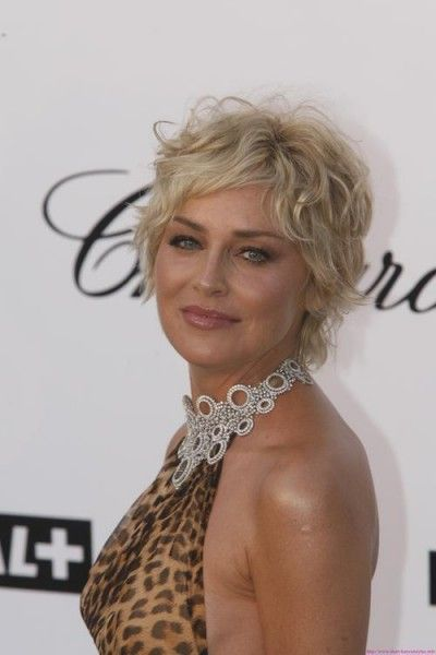 beautiful short curly haircut with bangs for older women with blonde hair color