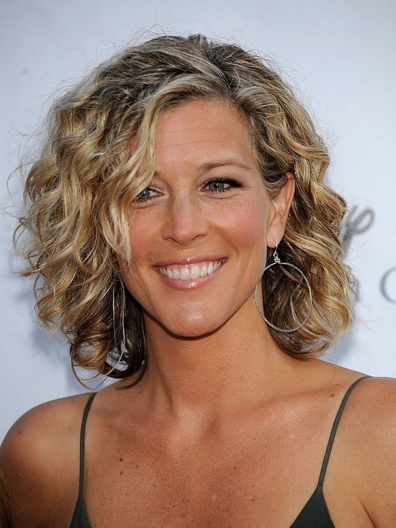 beautiful short wavy curly haircut for women over 50