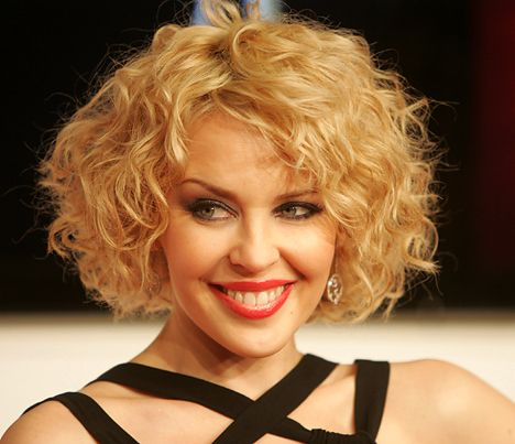 54 Awesome Short Curly Hairstyles for Women over 50 beautiful-side-parted-curly-short-hairstyle-that-looks-beautiful-with-over-50-women