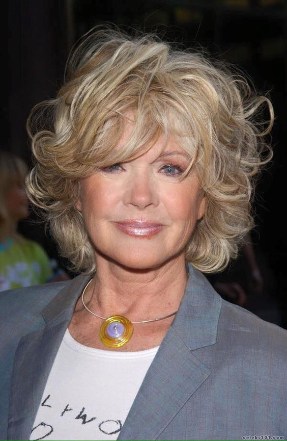 cute wavy curly haircut with bangs for older women with thin hair