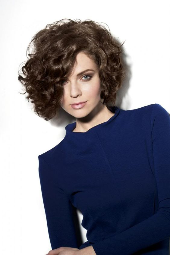 high volume bob hairstyle for women with thick curly hair