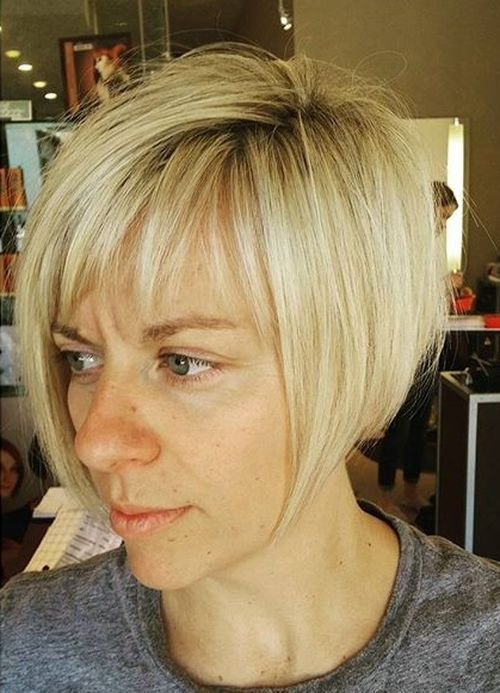 45 Short Hairstyles for Grey Hair and Glasses that Make Older Women Still Looking Stylish angled_bob_hairdo_for_older_Women_3