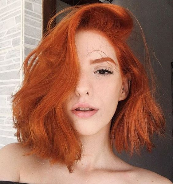 Natural Red Hairstyle for Women Over 50 with Fine Hair 1