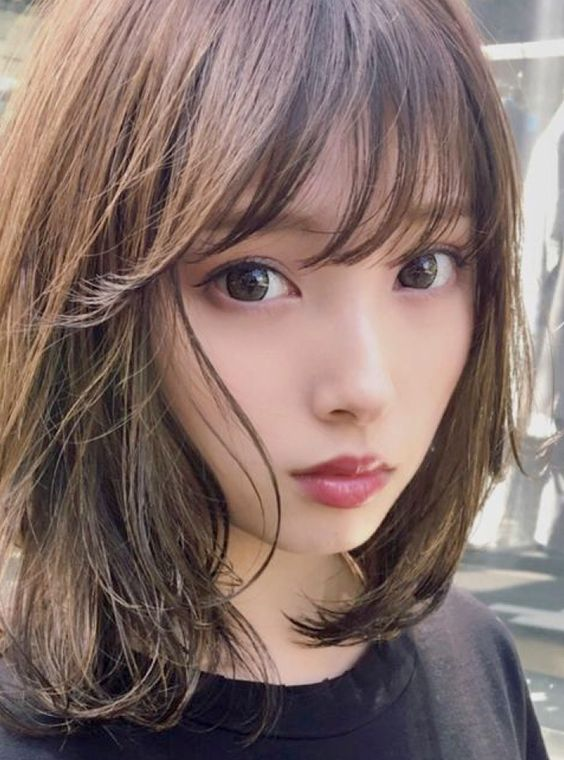 72 Cute and Chic Asian Hairstyles for Women Eye-Covering-Bangs-Asian-Women-Hairstyles-1