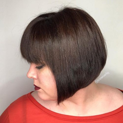 20 Charming Short Brown Hairstyles for Women Over 60 (Updated 2021) Stacked-angled-brown-pixie-with-bangs