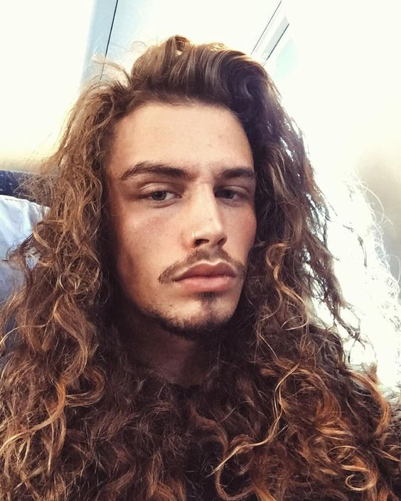 Thick Curls long hairstyles for men with thick hair 11
