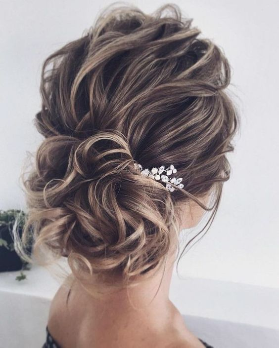 Updo Hairstyles for Weddings to Emphasize the Beauty and Elegance of the Bride 9f0b7ae1f18fb86b2de905b2c2c218f1
