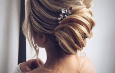 Updo Hairstyles for Weddings to Emphasize the Beauty and Elegance of the Bride a4c18d6033049f587d0449a619b245a0-235x150