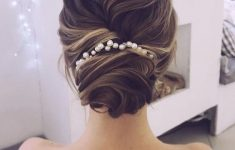 Updo Hairstyles for Weddings to Emphasize the Beauty and Elegance of the Bride bf5a2f63c49b349b84f3ed76c7b540f1-235x150