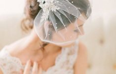 Low Bun with Veil and Tiara