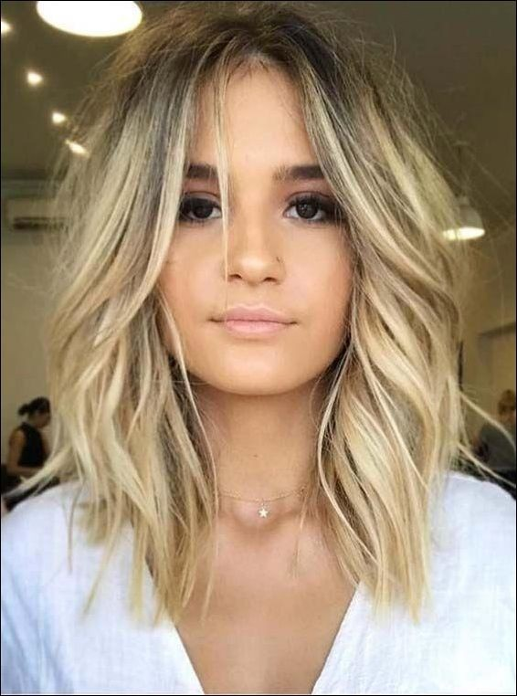 6 Trendy Medium Length Hairstyles to Enhance Your Look 6b523eec7e208222af6638379c1ab049